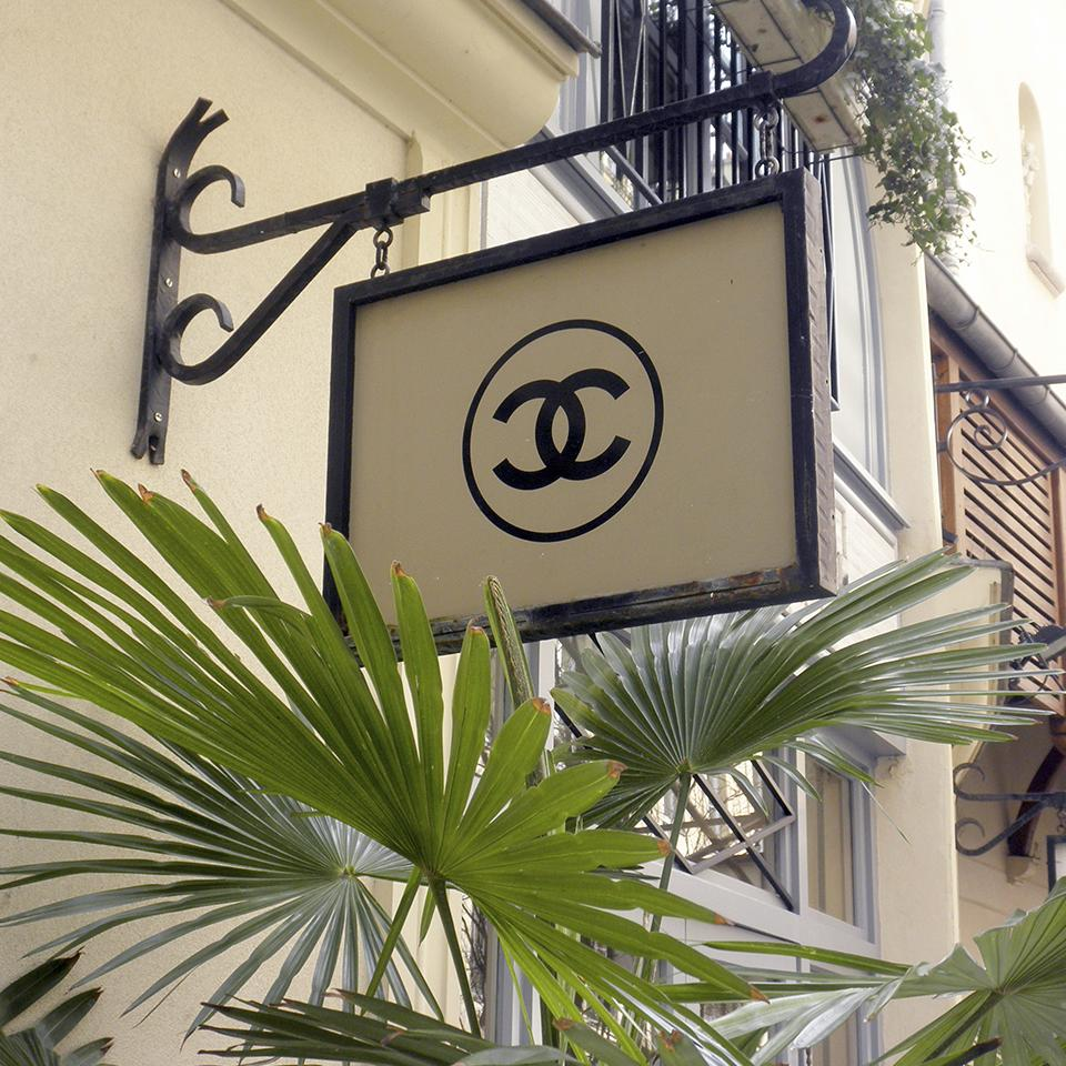 Suspended Chanel store sign by Visotec